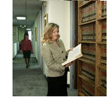 Mary Bennett, Appellate Lawyer standing at bookcase
