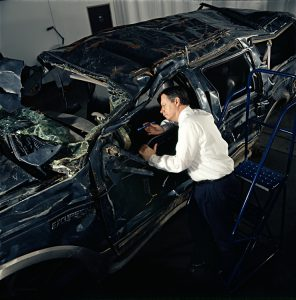 Inspecting Interior of crashed car